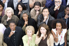 Group Of People With Finger On Lips Royalty Free Stock Image