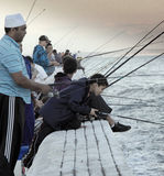 Group of people fishing on False Bay waters stock images