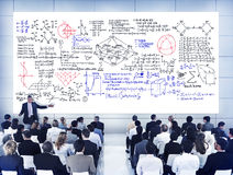 Group of People with Formula on the White Board Stock Image