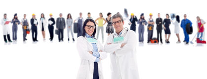 Group of people in front two doctors. Group of industrial workers,workers physician and bussines people stock photography