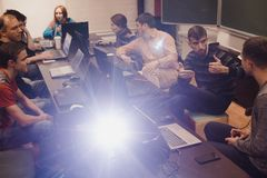 People with laptops communicating in classroom Stock Photos