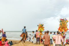 Group of people gathered at Marina beach, having fun in the ocean waves with beautiful clouds,Chennai,India 19 aug 2017. Group of people gathered at Marina beach royalty free stock images