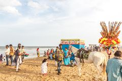 Group of people gathered at Marina beach, having fun in the ocean waves with beautiful clouds,Chennai,India 19 aug 2017 Royalty Free Stock Images