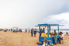 Group of people gathered at Marina beach, having fun in the ocean waves with beautiful clouds, Chennai, India 19 aug 2017. Group of people gathered at Marina royalty free stock images
