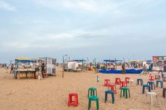 Group of people gathered at Marina beach, having fun in the ocean waves with beautiful clouds,Chennai,India 19 aug 2017 Stock Photography