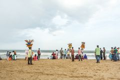 Group of people gathered at Marina beach, having fun in the ocean waves with beautiful clouds,Chennai,India 19 aug 2017. Group of people gathered at Marina beach stock photos