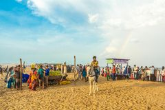 Group of people gathered at Marina beach, having fun in the ocean waves with beautiful clouds,Chennai,India 19 aug 2017. Group of people gathered at Marina beach stock photography