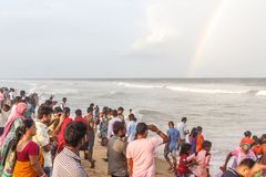 Group of people gathered at Marina beach, having fun in the ocean waves with blue sky, rainbow formation,Chennai 19 aug 2017 Stock Photos