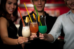 Group of people gathering in cocktail bar and having fun Stock Photo