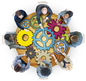 Group of People with Gear Symbol Photo Illustration Stock Image