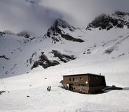 Cabin Hut in the Snow Mountains stock image
