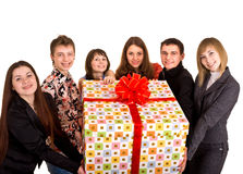 Group of people and gift box. Stock Photos