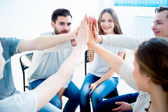 Group of people giving high five Royalty Free Stock Image