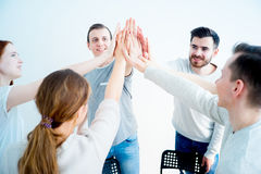 Group of people giving high five royalty free stock photography