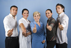 Group of people giving thumbs up stock photos