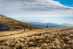 A group of people go along the mountain stock photos