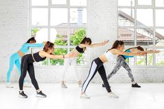 A group of people go in for sports in the gym. The concept of sports, a healthy lifestyle, fitness, stretching and dancing.  royalty free stock photography