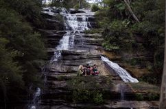 Group of People on Grey Black and White Water Falls Royalty Free Stock Photo