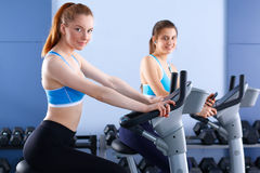Group of people at the gym exercising on cross Stock Images