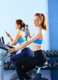 Group of people at the gym exercising on cross trainers.  Stock Photography