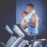 Group of people at the gym exercising on cross trainers.  Stock Image