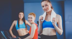 Group of people at the gym exercising on cross trainers.  Royalty Free Stock Photography