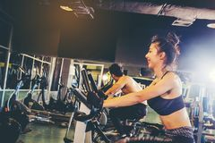 Group of people in the gym exercising legs doing cardio training Royalty Free Stock Image