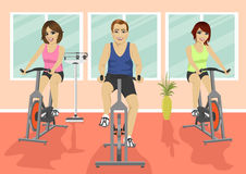 Group of people in gym, exercising their legs doing cardio training Stock Photography