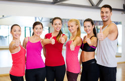 Group of people in the gym showing thumbs up Royalty Free Stock Photography