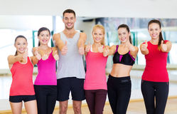 Group of people in the gym showing thumbs up Royalty Free Stock Image