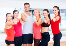 Group of people in the gym showing thumbs up Royalty Free Stock Images