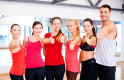 Group of people in the gym showing thumbs up Royalty Free Stock Photos