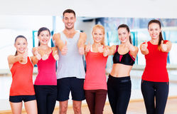 Group of people in the gym showing thumbs up Stock Photos