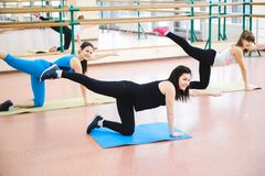 Group of people at the gym in a stretching class royalty free stock photos