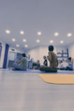 Group of people at the gym in a yoga class Stock Image