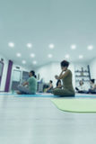 Group of people at the gym in a yoga class Stock Photography