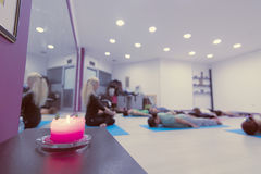 Group of people at the gym in a yoga class Royalty Free Stock Photo