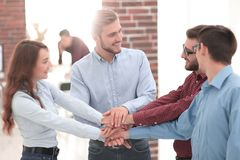 Group of people hands together partnership teamwork. royalty free stock image