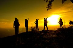 Group of people, Happy hiking standing on a cliff Royalty Free Stock Image
