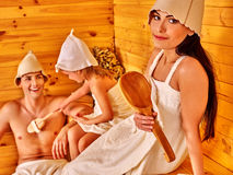 Group people in hat  at sauna. Family with mother and father  in hat  relaxing at sauna Stock Image