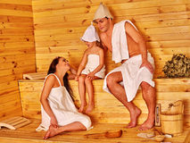 Group people in hat  at sauna. Royalty Free Stock Image