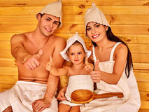 Group people in hat  at sauna. Family of three persons in hat  relaxing at sauna and showing thumb up Royalty Free Stock Image