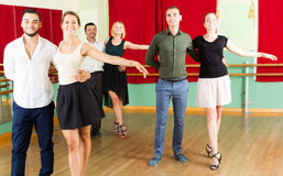 Group of people have fun while dancing waltz Stock Image