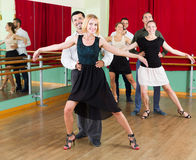 Group of people have fun while dancing waltz Royalty Free Stock Image