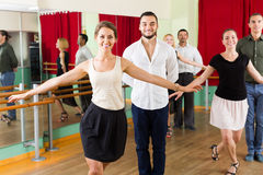 Group of people have fun while dancing waltz Stock Photos