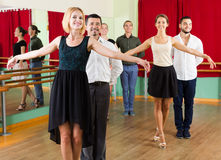 Group of people have fun while dancing waltz Royalty Free Stock Photos