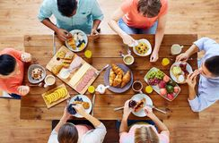 Group of people having breakfast at table Stock Photo