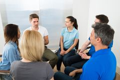 Group of people having discussion Stock Image