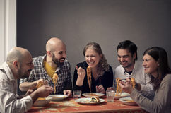 Group of people having a family lunch stock photography