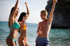 Group of happy people having fun at summer. Beach vacation friends travel concept stock photo